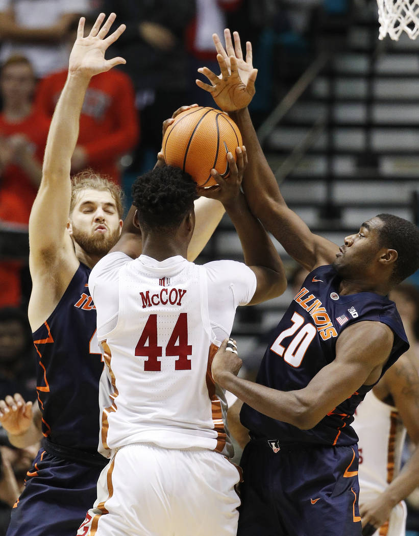 Illinois' Michael Finke, left, and Da'Monte Williams, right, guard UNLV's Brandon McCoy during the second half of an NCAA college basketball game Saturday, Dec. 9, 2017, in Las Vegas. (AP Photo/Jo ...