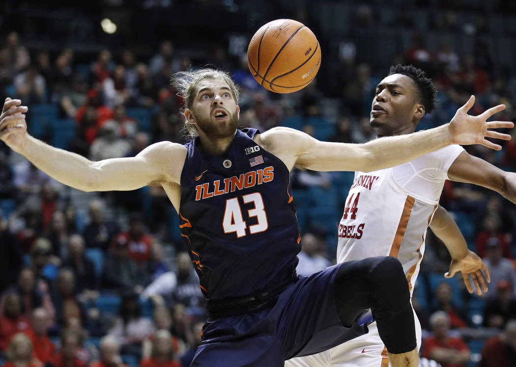 UNLV's Brandon McCoy, right, blocks a shot by Illinois' Michael Finke during the second half of an NCAA college basketball game Saturday, Dec. 9, 2017, in Las Vegas. (AP Photo/John Locher)