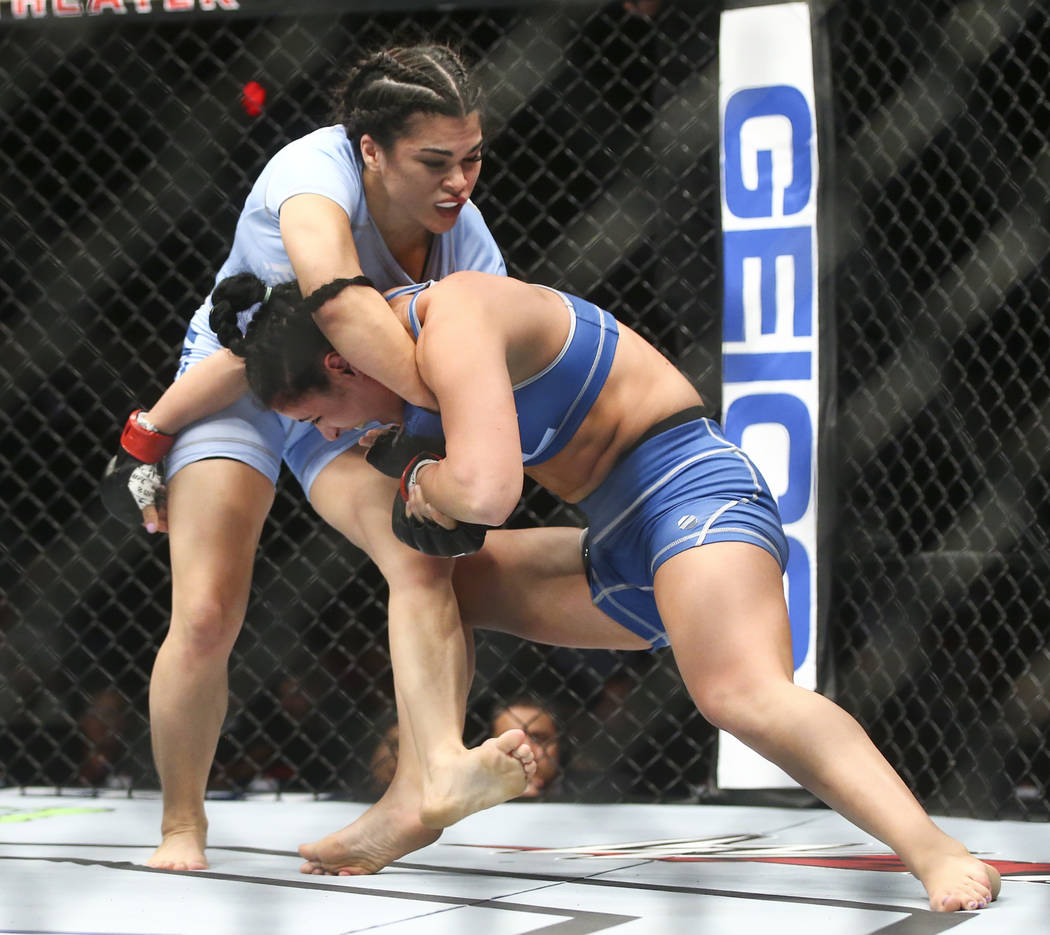 """Rachael Ostovich, left, fights Karine Gevorgyan during a women's flyweight bout in """"The Ultimate Fighter""""Season 26 Finale card at the Park Theater at Monte Carlo in Las Veg ..."""