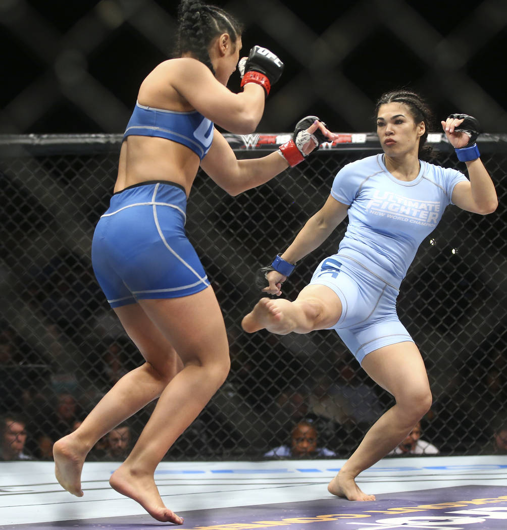 """Karine Gevorgyan, left, fights Rachael Ostovich during a women's flyweight bout in """"The Ultimate Fighter""""Season 26 Finale card at the Park Theater at Monte Carlo in Las Veg ..."""