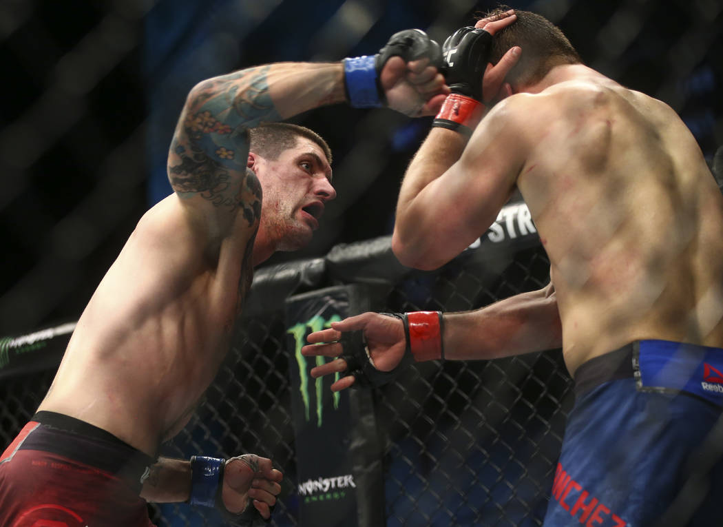 Ryan Janes, left, fights Andrew Sanchez in their middleweight bout during the ÒThe Ultimate FighterÓ Season 26 Finale card at the Park Theater at Monte Carlo in Las Vegas on Friday, Dec. ...