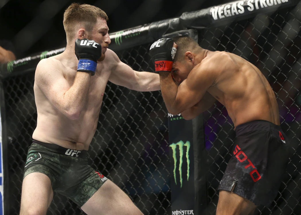 """Brett Johns, left, fights Joe Soto in their bantamweight bout during """"The Ultimate Fighter"""" Season 26 Finale card at the Park Theater at Monte Carlo in Las Vegas on Friday, Dec.  ..."""