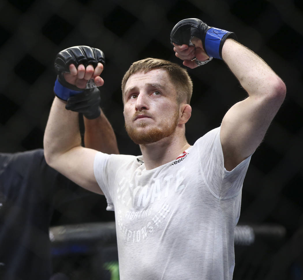 """Brett Johns reacts after defeating Joe Soto via calf slicer submission in the first round of their bantamweight bout during """"The Ultimate Fighter"""" Season 26 Finale card at the Pa ..."""