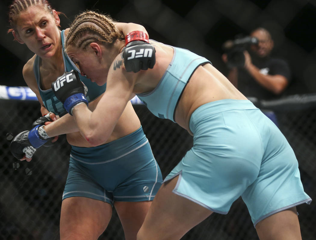 """DeAnna Bennett, left, fights Melinda Fabian during a women's flyweight bout in """"The Ultimate Fighter"""" Season 26 Finale card at the Park Theater at Monte Carlo in Las Vegas o ..."""