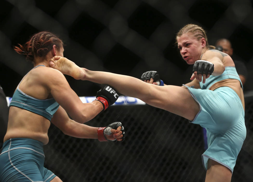 """Melinda Fabian, right, knocks down DeAnna Bennett with a kick during a women's flyweight bout in """"The Ultimate Fighter"""" Season 26 Finale card at the Park Theater at Monte Carlo i ..."""