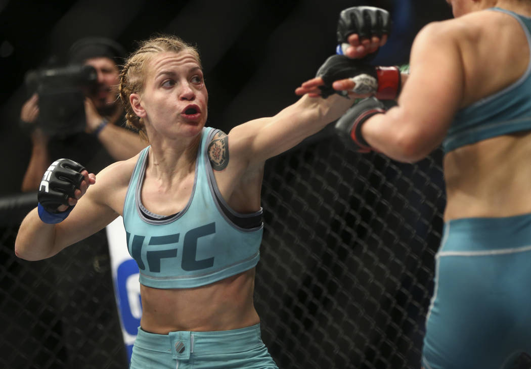 """Melinda Fabian, left, fights DeAnna Bennett during a women's flyweight bout in """"The Ultimate Fighter"""" Season 26 Finale card at the Park Theater at Monte Carlo in Las Vegas on Fri ..."""