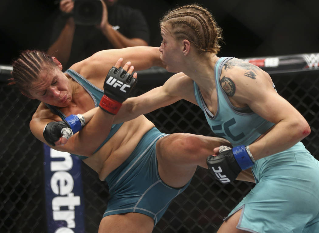 """DeAnna Bennett, left, takes a hit from Melinda Fabian during a women's flyweight bout in """"The Ultimate Fighter"""" Season 26 Finale card at the Park Theater at Monte Carlo in Las Ve ..."""