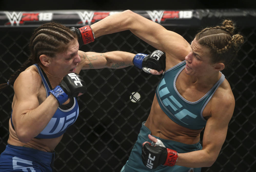 Lauren Murphy, left, fights Barb Honchak during a women's flyweight bout at the Park Theater at Monte Carlo in Las Vegas on Friday, Dec. 1, 2017. Murphy won via split decision. Chase Steven ...