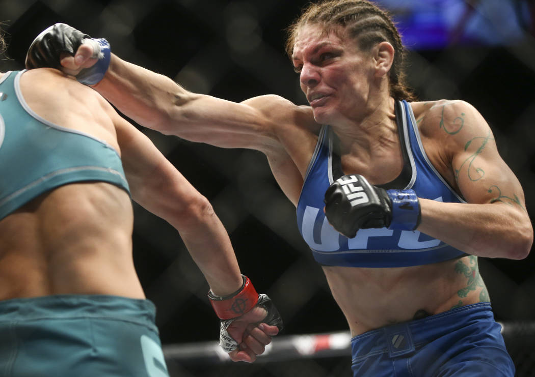 Lauren Murphy, right, fights Barb Honchak during a women's flyweight bout at the Park Theater at Monte Carlo in Las Vegas on Friday, Dec. 1, 2017. Murphy won via split decision. Chase Stevens Las  ...