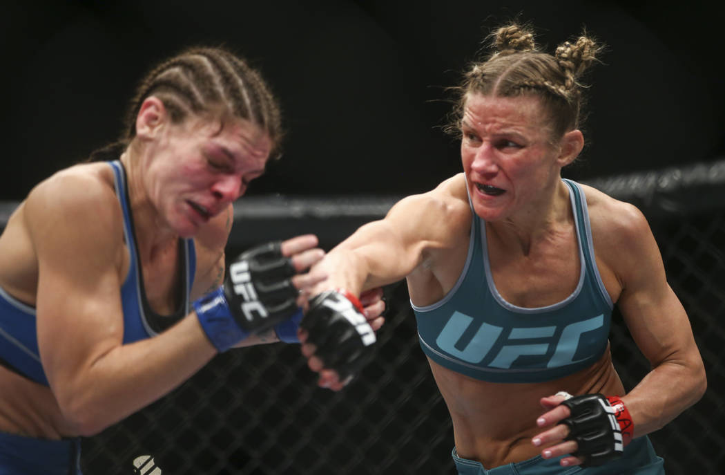 Lauren Murphy, left, takes a hit from Barb Honchak during a women's flyweight bout at the Park Theater at Monte Carlo in Las Vegas on Friday, Dec. 1, 2017. Murphy won via split decision. Chase Ste ...