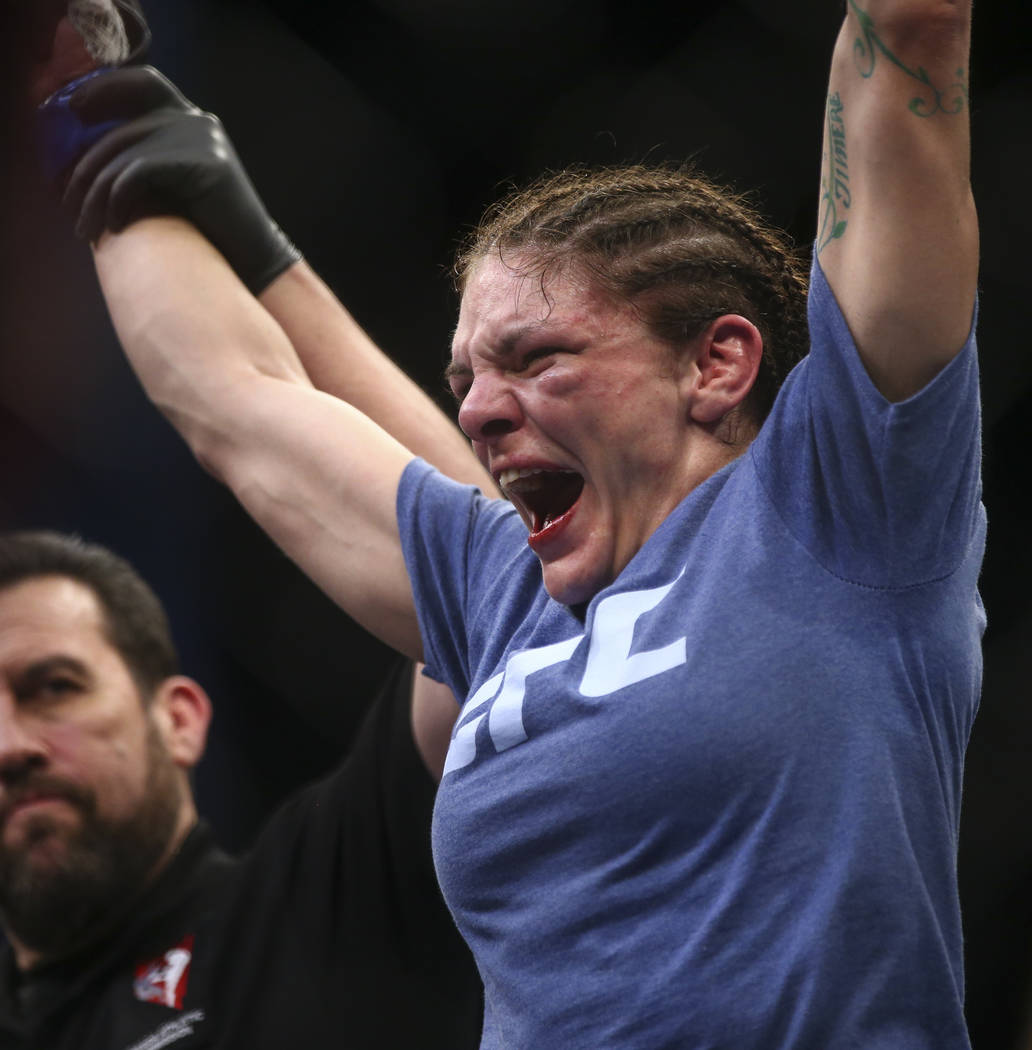 Lauren Murphy celebrates after defeating Barb Honchak via split decision in a women's flyweight bout at the Park Theater at Monte Carlo in Las Vegas on Friday, Dec. 1, 2017. Chase Stevens Las Vega ...