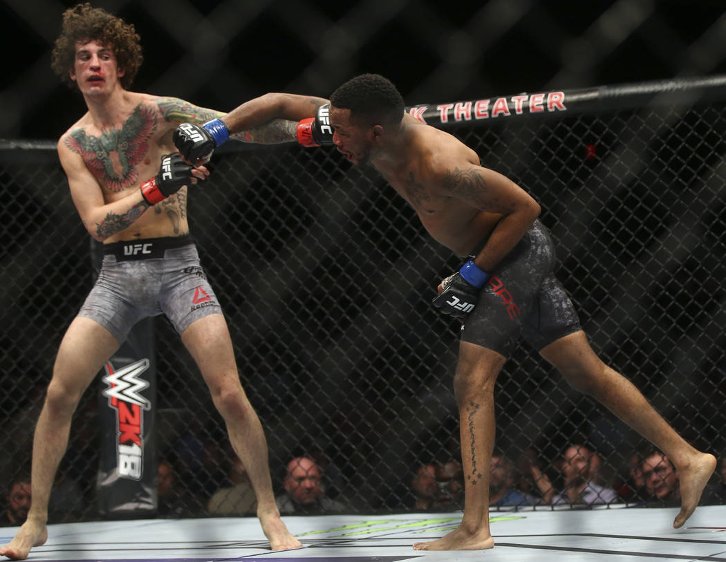 Sean O'Malley, left, fights Terrion Ware in their bantamweight bout at the Park Theater at Monte Carlo in Las Vegas on Friday, Dec. 1, 2017. O'Malley won via unanimous decision. Chas ...