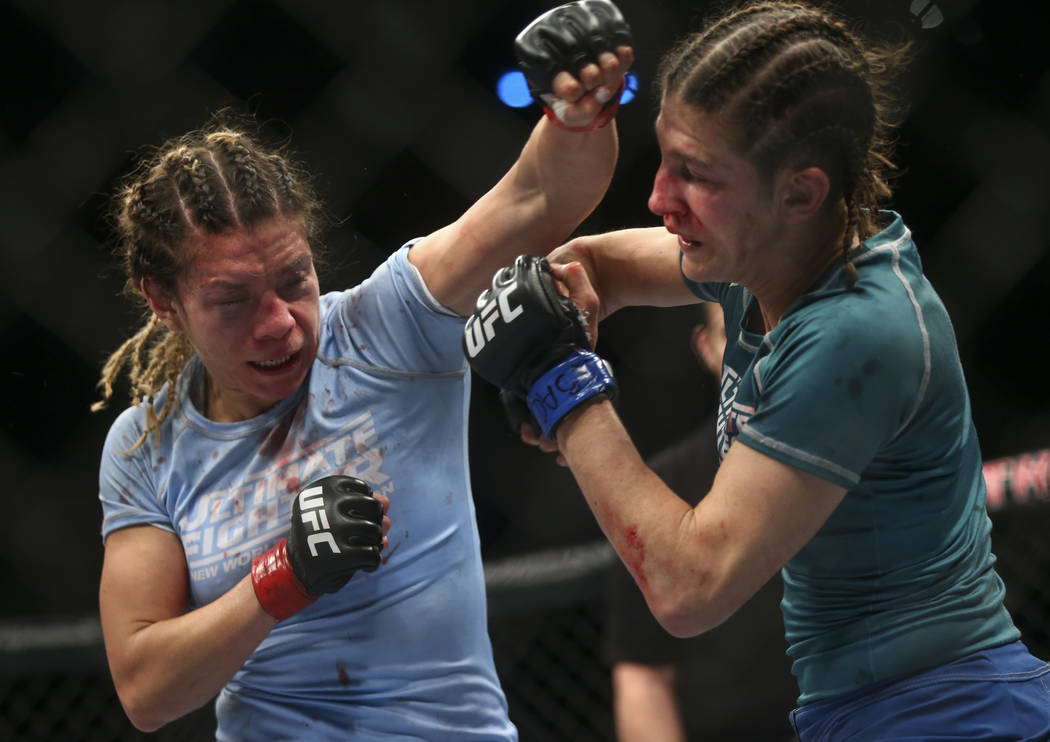 Nicco Montano, left, fights Roxanne Modafferi during a women's flyweight title bout  at the Park Theater at Monte Carlo in Las Vegas on Friday, Dec. 1, 2017. Montano won via unanimous decis ...