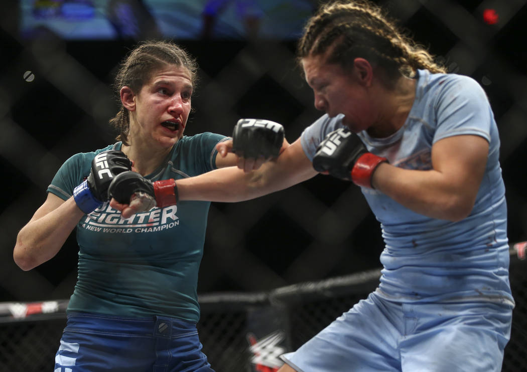Roxanne Modafferi, left, fights Nicco Montano during a women's flyweight title bout  at the Park Theater at Monte Carlo in Las Vegas on Friday, Dec. 1, 2017. Montano won via unanimous decision. Ch ...