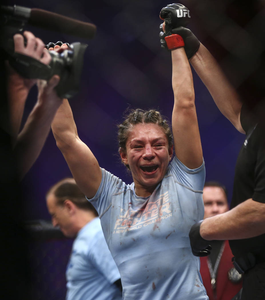 Nicco Montano celebrates after defeating Roxanne Modafferi via unanimous decision in a women's flyweight title bout  at the Park Theater at Monte Carlo in Las Vegas on Friday, Dec. 1, 2017. Chase  ...