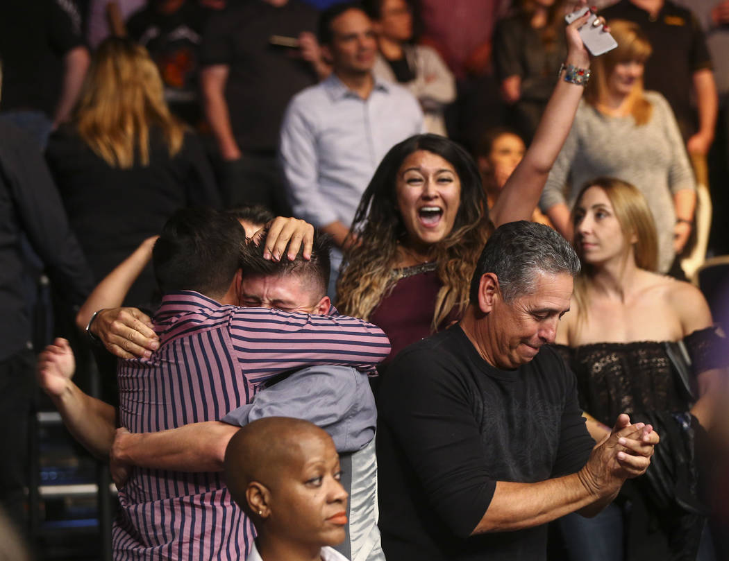 Supporters of Nicco Montano, not pictured, celebrates her win over Roxanne Modafferi via unanimous decision in a women's flyweight title bout at the Park Theater at Monte Carlo in Las ...