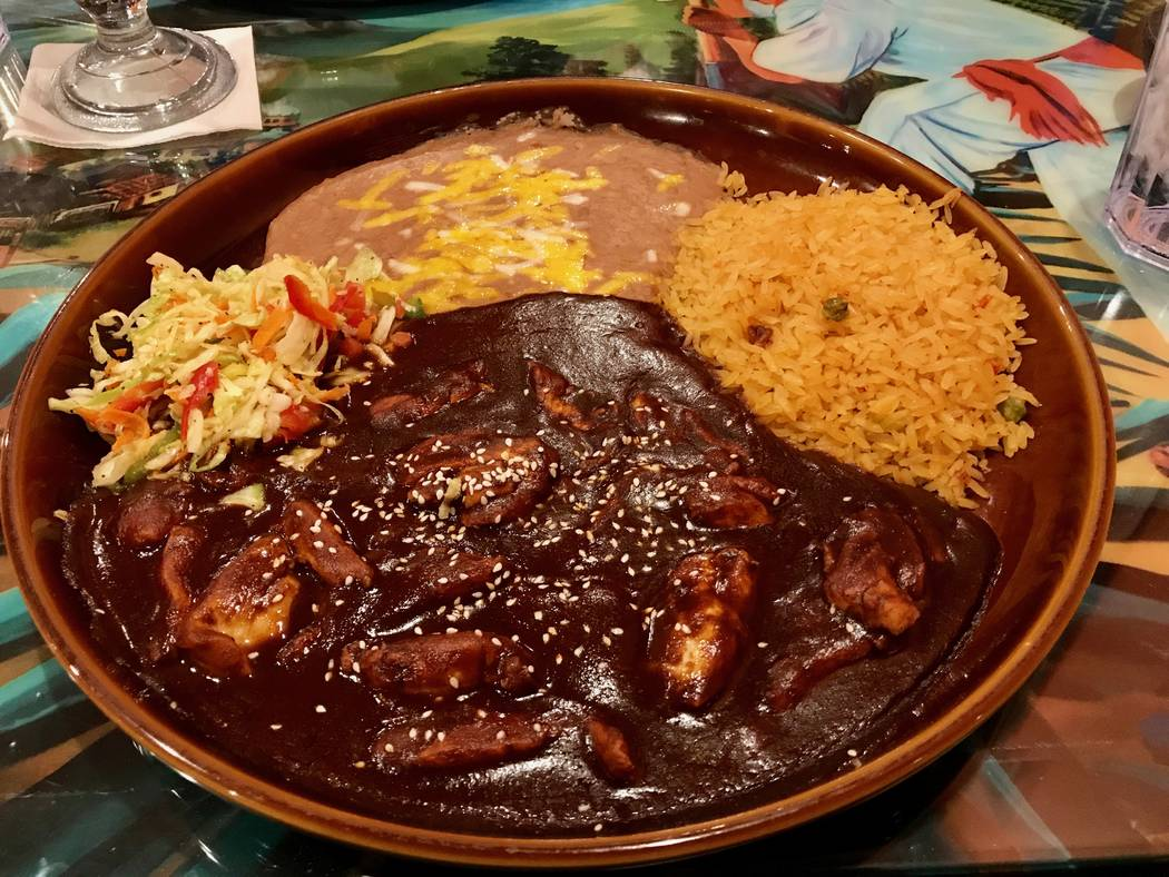 Pollo en mole, or chicken strips in a sweet chili sauce, served with rice, beans and tortillas ($15.50) (Madelyn Reese/View) @MadelynGReese