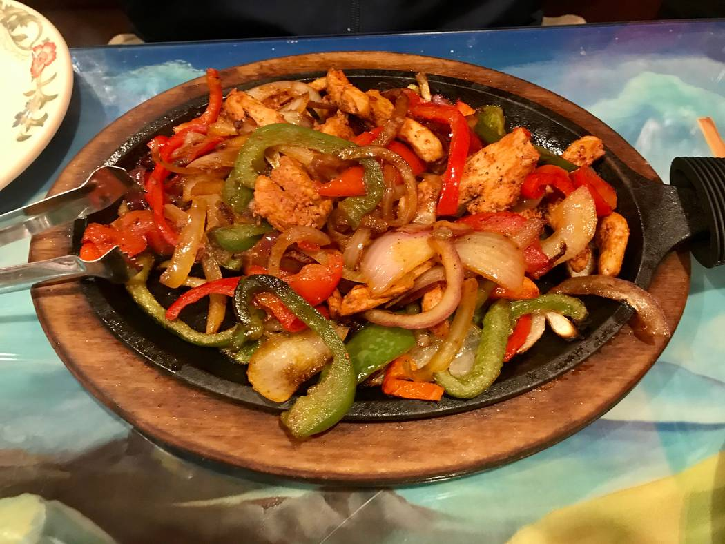 Chicken fajitas served with guacamole, beans, rice, sour cream and tortillas ($16.50) (Madelyn Reese/View) @MadelynGReese