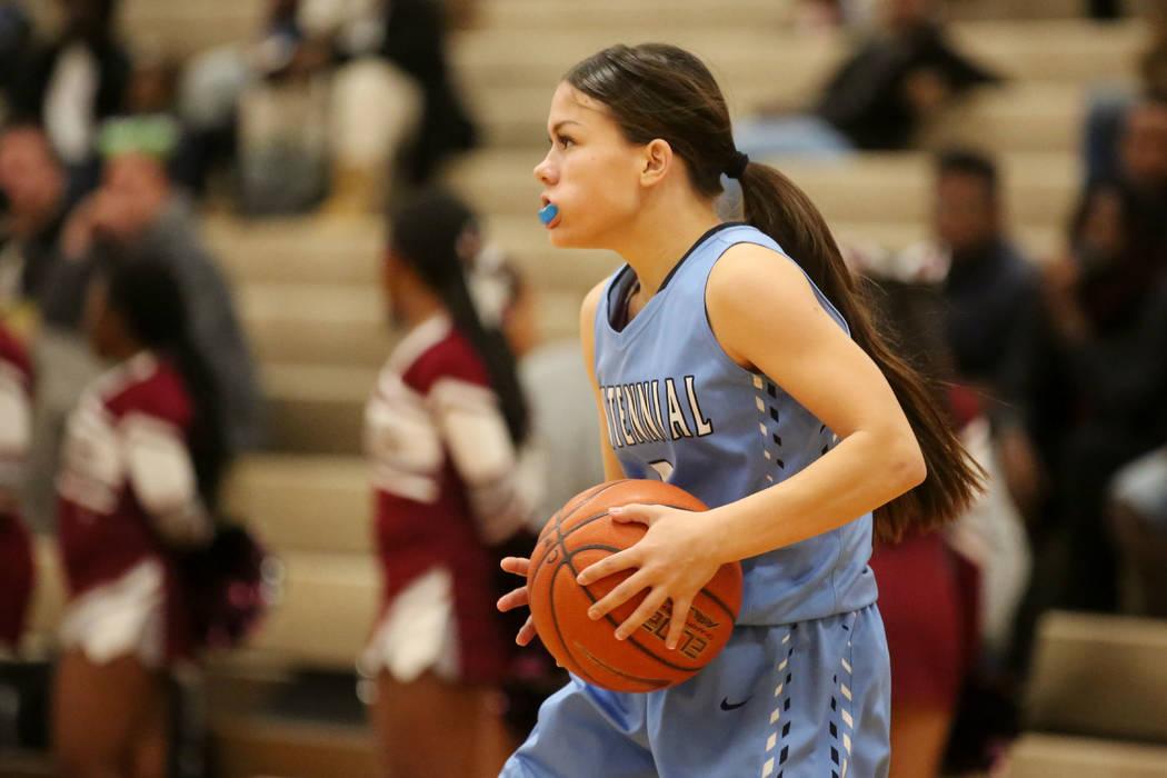 Centennial basketball player Melanie Isbell (2) handles the ball during a game against Cimarron-Memorial at Cimarron-Memorial High School in Las Vegas, Tuesday, Dec. 5, 2017. Bridget Bennett Las V ...