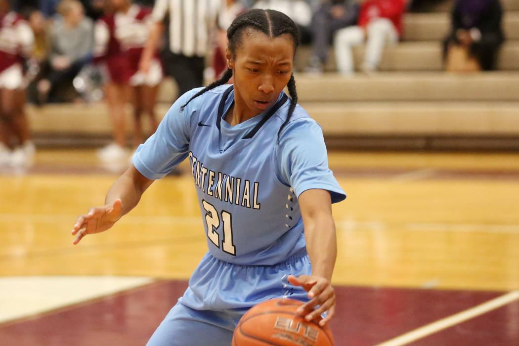 Centennial girls basketball player Justice Ethridge (21) reaches for the ball during a game against Cimarron-Memorial at Cimarron-Memorial High School in Las Vegas, Tuesday, Dec. 5, 2017. Bridget  ...