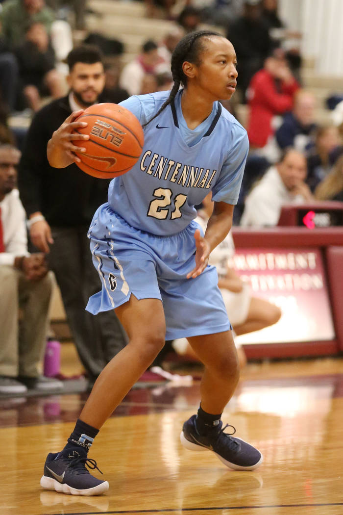 Centennial girls basketball player Justice Ethridge (21) handles the ball during a game against Cimarron-Memorial at Cimarron-Memorial High School in Las Vegas, Tuesday, Dec. 5, 2017. Bridget Benn ...