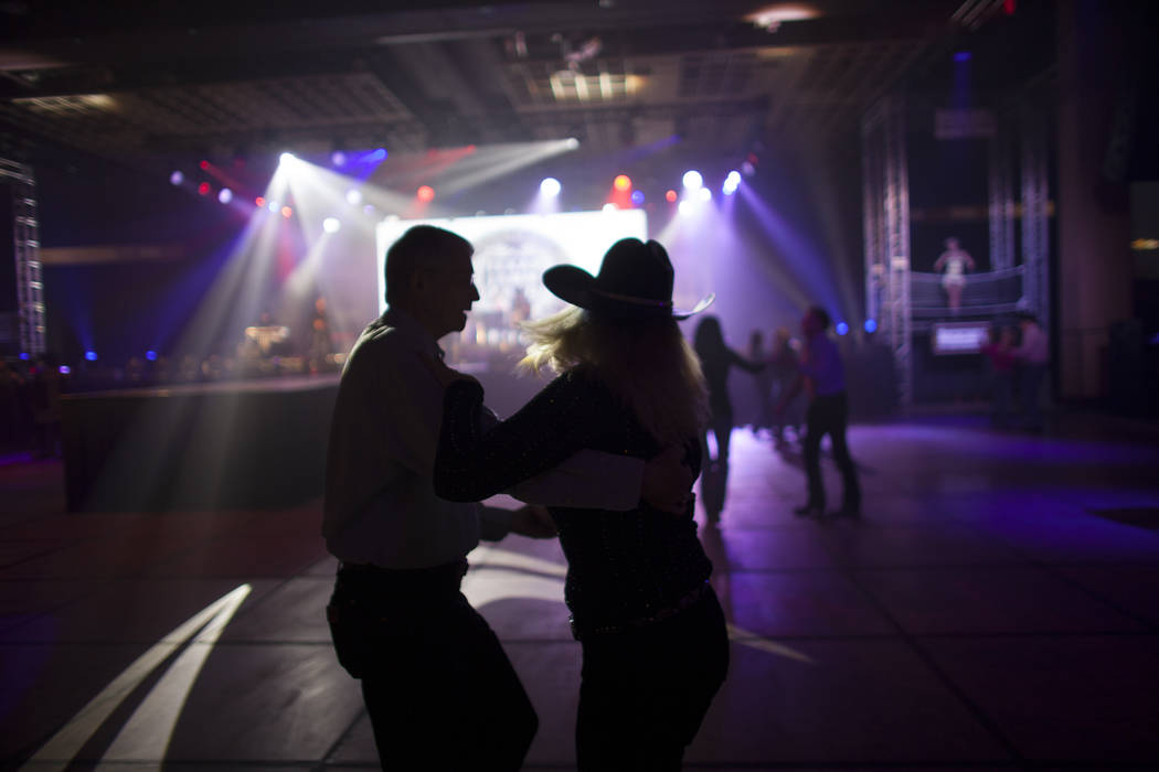 Chuck Shores dances with Lynn Brooks at the Gold Buckle Zone at the MGM Grand in Las Vegas. (Rachel Aston/Las Vegas Review-Journal) @rookie__rae