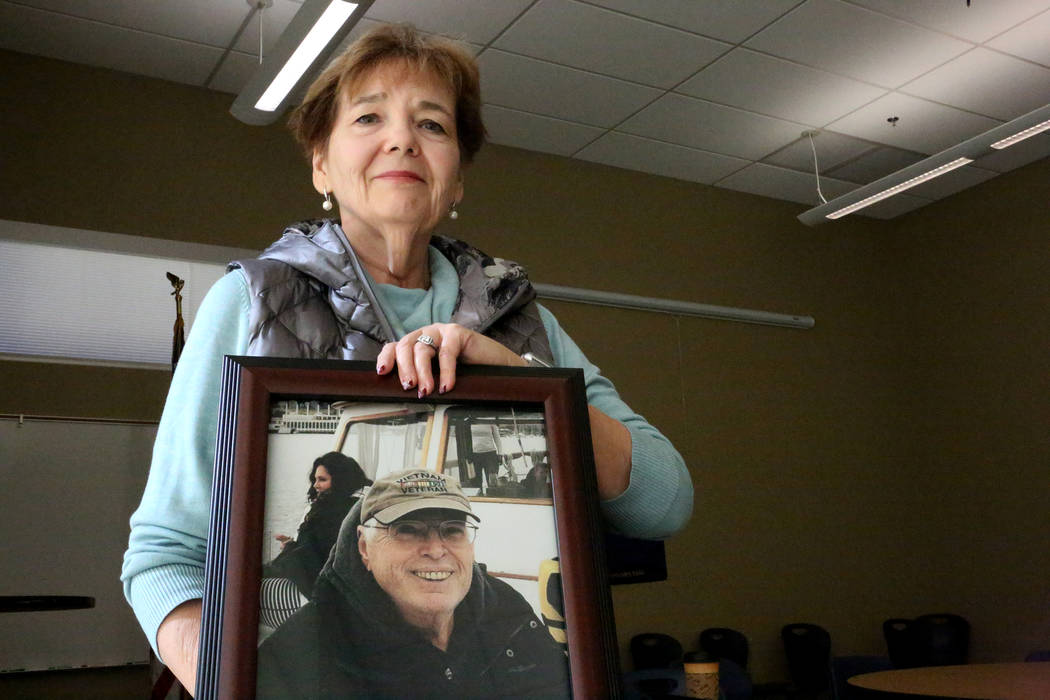 After a 'Veterans Coffee and Conversations' gathering at Vegas PBS on Friday, Nov. 17, 2017, Barbara Rodgick, 67, holds a photo of her late husband Bill who was a Vietnam Veteran tha ...