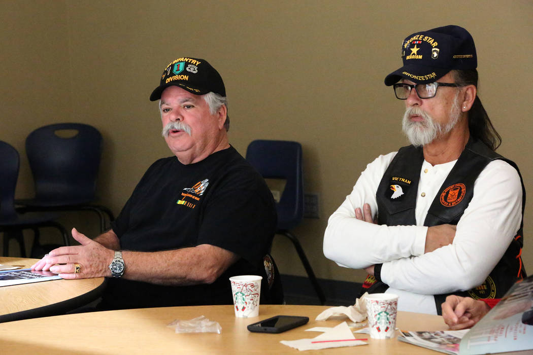 Vietnam Veterans of America Chapter #1076 President Neil C. Johnson, left, sits next to Chapter Secretary and Agent Orange Chair Andrew J. LeDuc and answers questions during a 'Veterans Cof ...