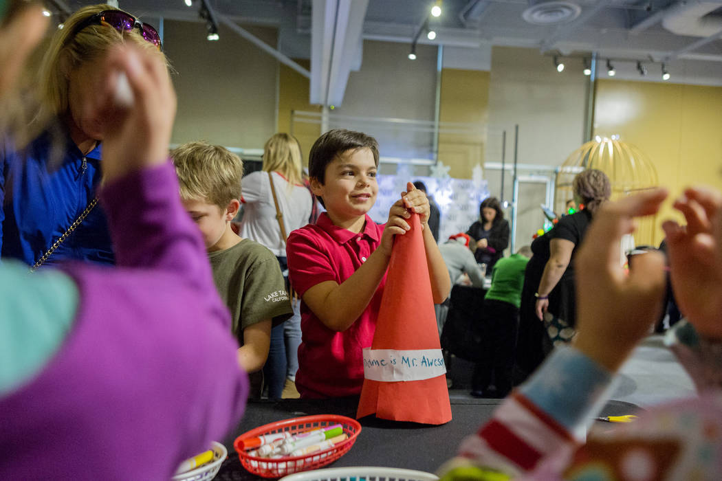 Henry White, 8, makes an elf hat during the Elf Adventure at the Discovery Children's Museum in Las Vegas Dec. 3, 2017. Elizabeth Brumley Las Vegas Review-Journal @EliPagePhoto