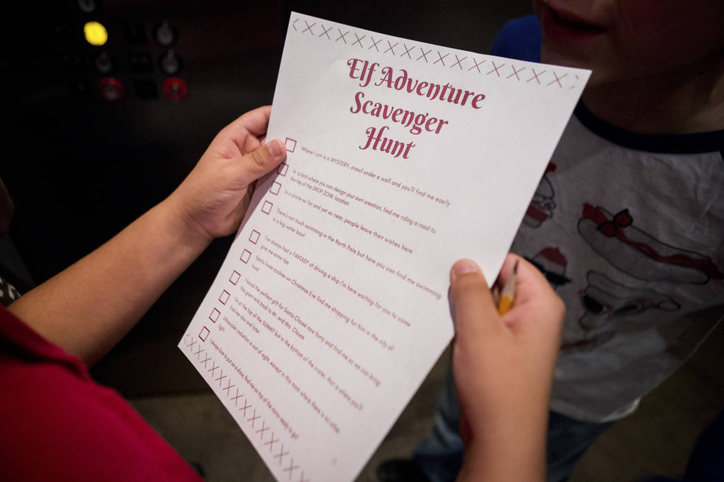 Henry White, 8, holds a scavenger hut list during the Elf Adventure at the Discovery Children's Museum in Las Vegas Dec. 3, 2017. Elizabeth Brumley Las Vegas Review-Journal @EliPagePhoto