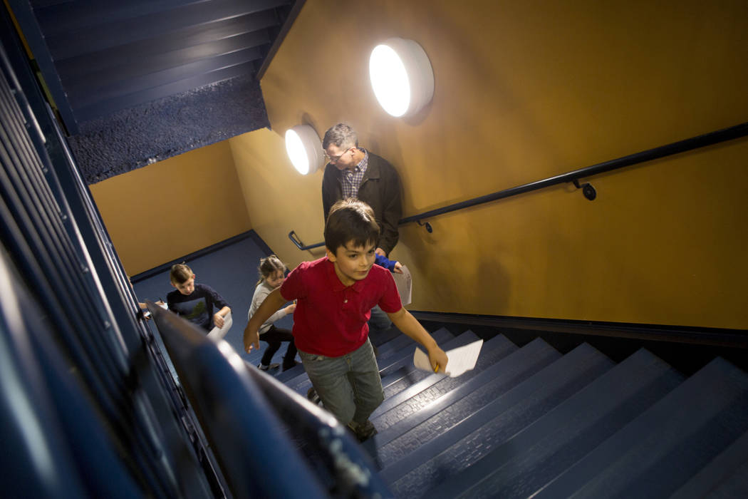 Henry White, 8, runs up the stairs with excitement to find elves hidden during the Elf Adventure at the Discovery Children's Museum in Las Vegas Dec. 3, 2017. Elizabeth Brumley Las Vegas Review-Jo ...