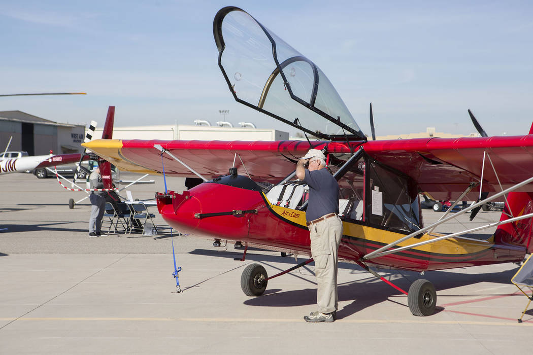 People look at aircrafts during the Aviation Open House and Car Show at North Las Vegas Airport in North Las Vegas, Saturday, Dec. 2, 2017. Bridget Bennett Las Vegas Review-Journal