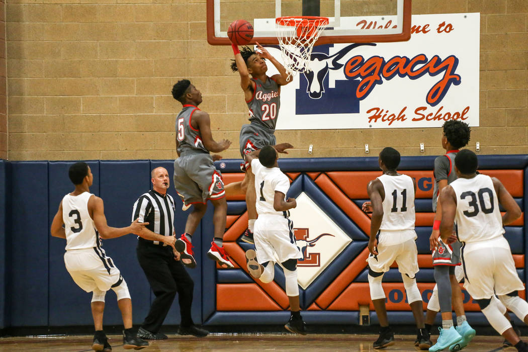 Arbor View's Comillion Smith (20) shoots the ball against Democracy Prep during the first quarter of the Legacy Tip-Off Classic basketball tournament quarterfinals at Legacy High School in North L ...