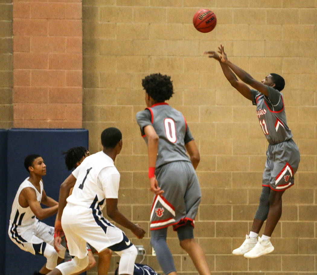 Arbor View's Amod Manor (11) shoots the ball against Democracy Prep during the first quarter of the Legacy Tip-Off Classic basketball tournament quarterfinals at Legacy High School in North Las Ve ...