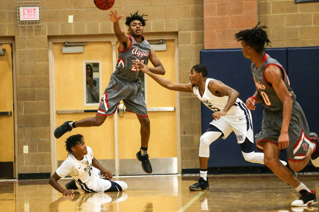 Arbor View's Sevonyea Smith (23) passes the ball against Democracy Prep during the second quarter of the Legacy Tip-Off Classic basketball tournament quarterfinals at Legacy High School in North L ...