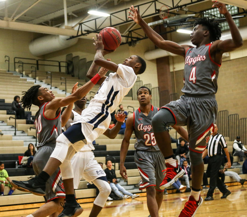 Democracy Prep's Najeeb Muhaamad (1), center, is fouled by Arbor View during the third quarter of the Legacy Tip-Off Classic basketball tournament quarterfinals at Legacy High School in North Las  ...