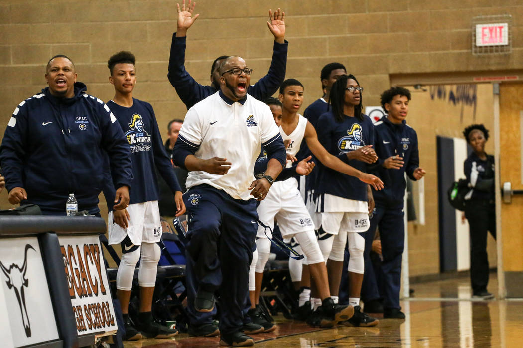 Democracy Prep's head coach Trevor Diggs reacts after scoring against Arbor View during the fourth quarter of the Legacy Tip-Off Classic basketball tournament quarterfinals at Legacy High School i ...
