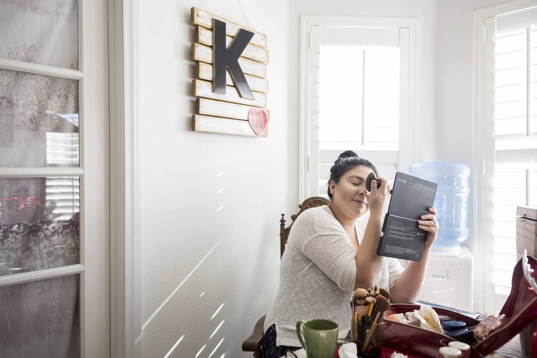 Kimberly Calderon gets ready for the day in her home in Las Vegas, Wednesday, Dec. 13, 2017. Elizabeth Brumley Las Vegas Review-Journal  @EliPagePhoto