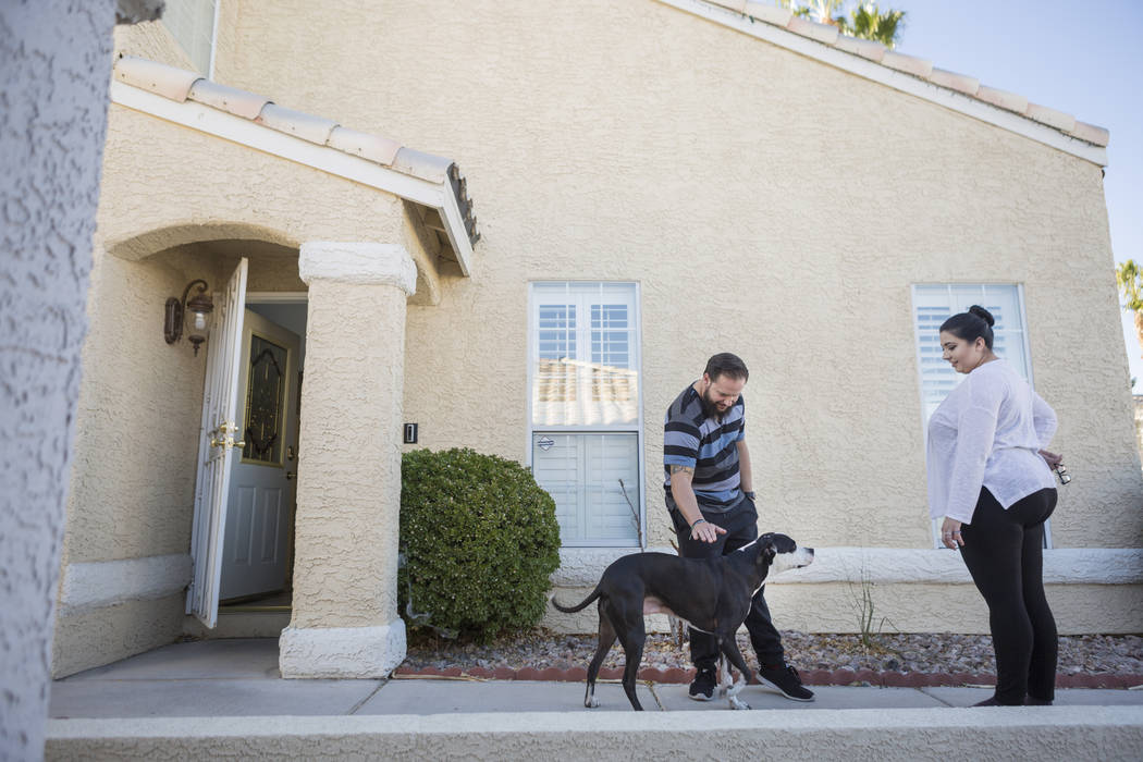 William King, left, and Kimberly Calderon outside of their   home in Las Vegas, Wednesday, Dec. 13, 2017. Elizabeth Brumley Las Vegas Review-Journal  @EliPagePhoto