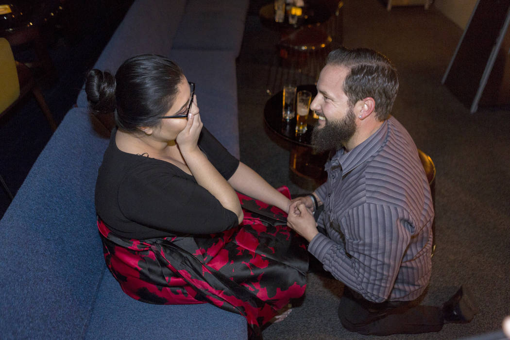 Kimberly Calderon, left, is in shock while William King proposes at the Delano Las Vegas hotel-casino in Las Vegas. Saturday, Dec. 9, 2017. Elizabeth Brumley Las Vegas Review-Journal  @EliPagePhoto