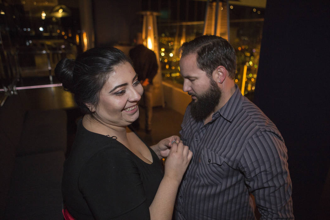 Kimberly Calderon, left, and William King, celebrate after King proposed and she accepted at the Delano Las Vegas hotel-casino in Las Vegas. Saturday, Dec. 9, 2017. Elizabeth Brumley Las Vegas Rev ...