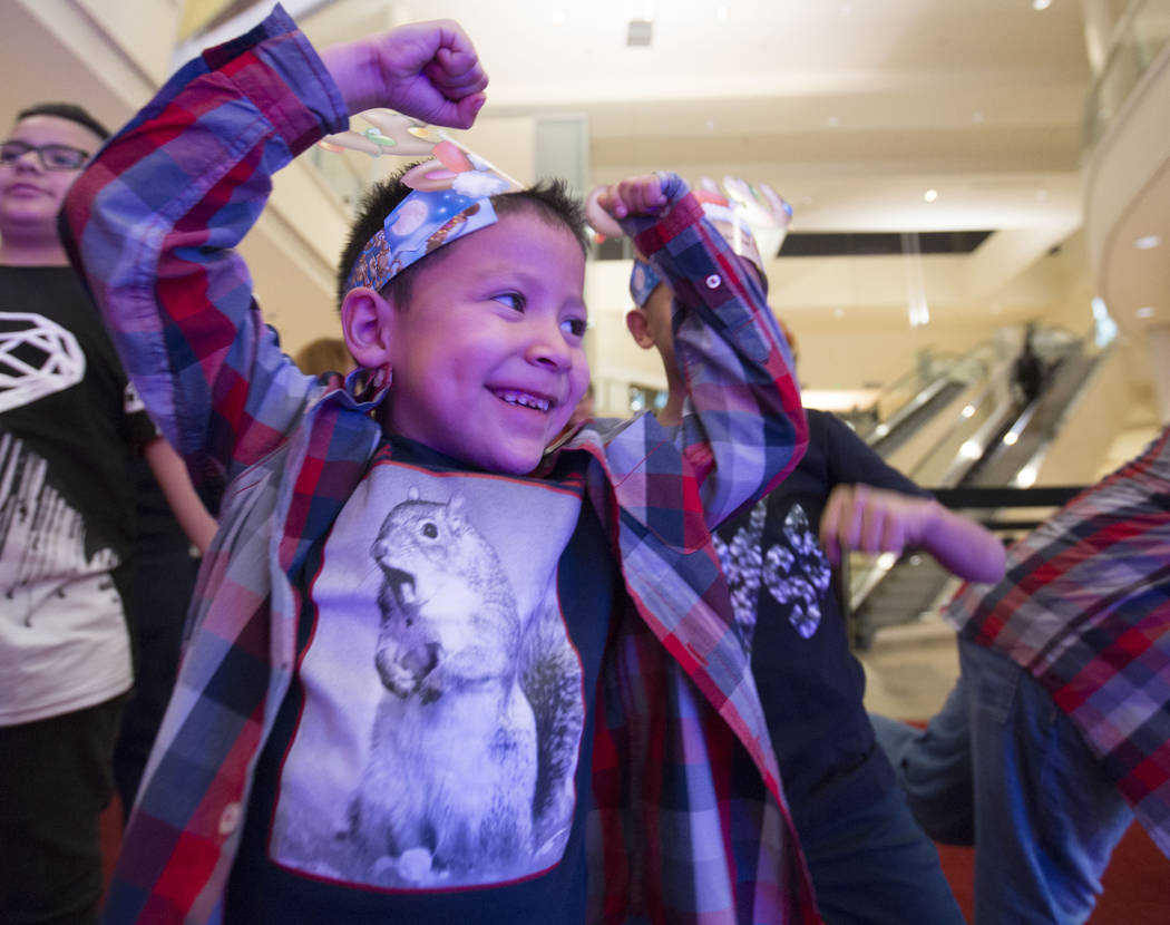 Maximus Calderon, 6, shows Santa how strong he is at Fashion Show Mall in Las Vegas, Wednesday, Dec. 6, 2017 in Las Vegas. Elizabeth Brumley Las Vegas Review-Journal  @EliPagePhoto