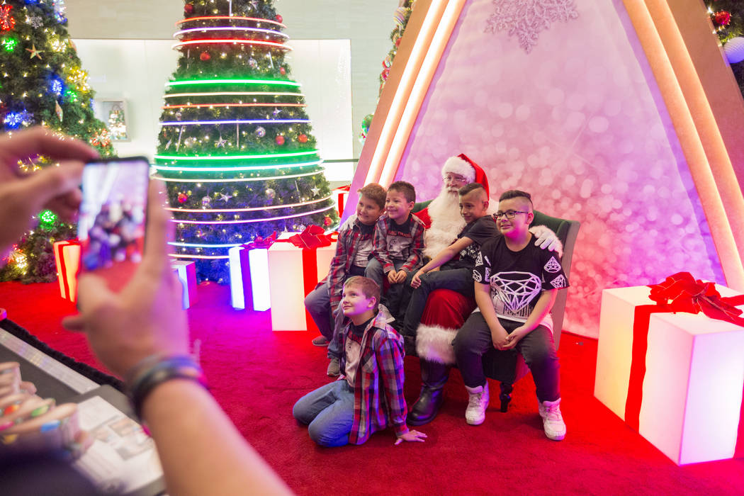 The King family and their cousins take a photo with Santa as a family tradition, at the Fashion Show Mall, Wednesday, Dec. 6, 2017 in Las Vegas. Elizabeth Brumley Las Vegas Review-Journal  @EliPag ...