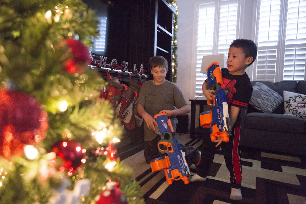 Enoch king, 9, and Maximus Calderon, 6, play with their toys given to them by Central Church, Wednesday, Dec. 6, 2017 in Las Vegas. Elizabeth Brumley Las Vegas Review-Journal  @EliPagePhoto