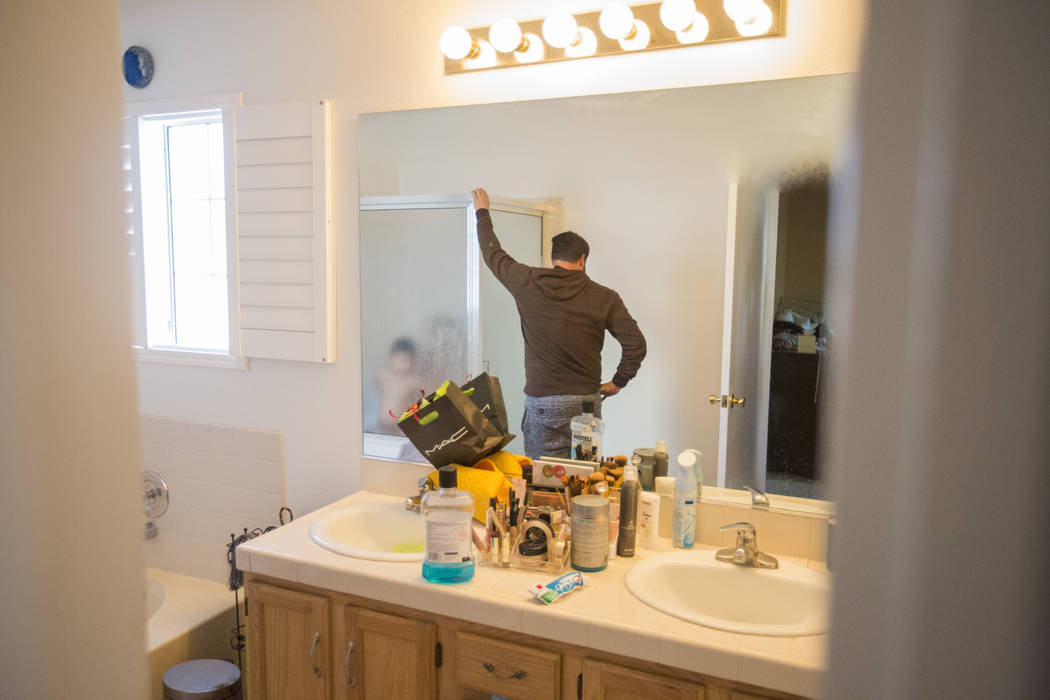 William King tells his kids to finish up in the shower to get ready for school, Thursday, Dec. 7, 2017 in Las Vegas. Elizabeth Brumley Las Vegas Review-Journal  @EliPagePhoto