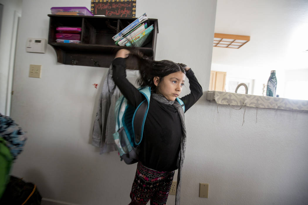 Velonee Calderon, 8, puts on her backpack in her Las Vegas home Friday, Dec. 8, 2017. Elizabeth Brumley Las Vegas Review-Journal  @EliPagePhoto