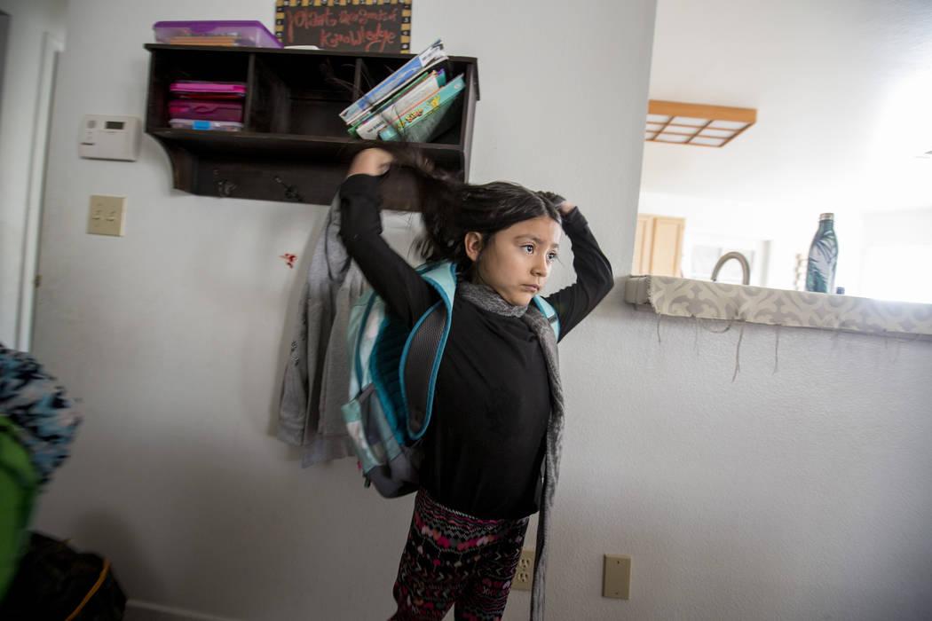 Velonee Calderon, 8, puts on her backpack in her Las Vegas home Friday, Dec. 8, 2017. Elizabeth Brumley Las Vegas Review-Journal  @EliPagePhoto