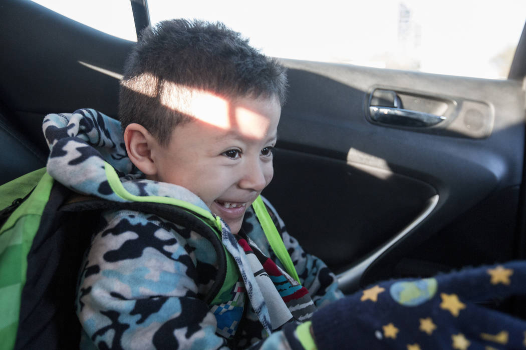 Maximus Calderon, 6, left, rides to school with his sister  Velonee Calderon, 8, in Las Vegas, Friday, Dec. 8, 2017. Elizabeth Brumley Las Vegas Review-Journal  @EliPagePhoto