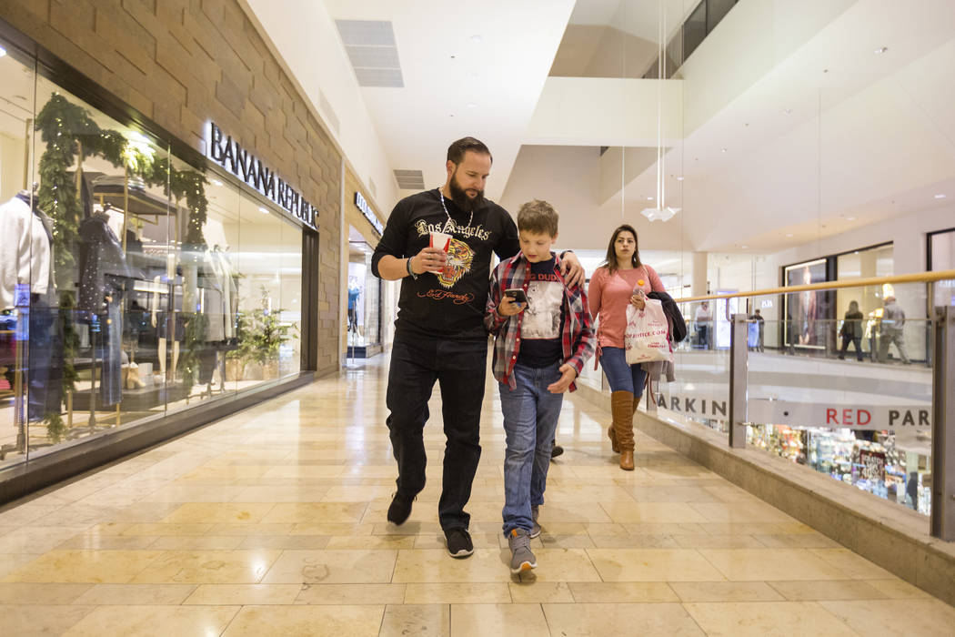 William King, left, walks with his son Enoch King, 9, at the Fashion Show mall in Las Vegas Wednesday, Dec. 6, 2017. Elizabeth Brumley Las Vegas Review-Journal  @EliPagePhoto