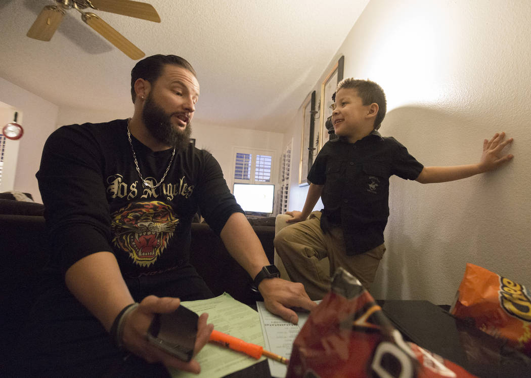 William King, left, helps his son Maximus Calderon, 6, with his homework in their Las Vegas home Wednesday evening, Dec. 6, 2017. Elizabeth Brumley Las Vegas Review-Journal  @EliPagePhoto